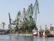 Shipyard cranes and tug boats in Varna , Bulgaria Stock Image