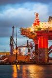 Shipyard at dusk. Shipyard industry - Oil Rig under construction in Gdansk, Poland Royalty Free Stock Photo