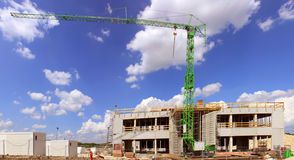 Shipyard Estate. Building construction site with a crane on blue sky background stock photos