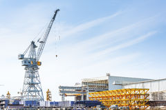 Shipyard of Fincantieri, working to build a new ship . Cranes at work in the shipyard in Trieste Royalty Free Stock Photo