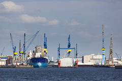 Shipyard in Hamburg, Germany. A large shipyard in Hamburg, Germany seen from the Elbe rivern Royalty Free Stock Image