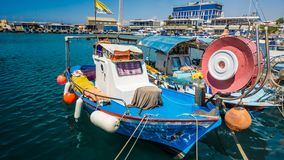 The old fishing boats are waving on the waves. Shipyard in Limassol, Cyprus, august 2017 royalty free stock images