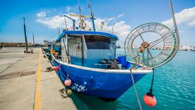 The old fishing boats are waving on the waves. Shipyard in Limassol, Cyprus, august 2017 stock photos