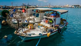 The old fishing boats are waving on the waves. Shipyard in Limassol, Cyprus, august 2017 royalty free stock image