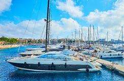 The shipyard with luxury yachts, Valletta, Malta. VALLETTA, MALTA - JUNE 17, 2018: Marina of Valletta with numerous yachts, bobbing on the waves and buildings of Stock Image