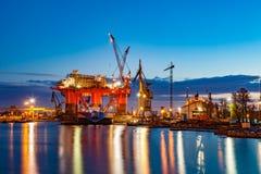Shipyard at night. Oil Rig in the shipyard for maintenance at night Stock Image