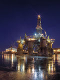 Shipyard at night. Oil rig under construction at night in Gdansk, Poland Royalty Free Stock Photo
