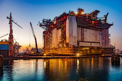 Shipyard at night. Oil rig under construction at night in Gdansk, Poland Stock Photography