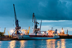 Shipyard with ship at dusk time Royalty Free Stock Image
