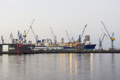 Shipyard with ships and cranes Stock Images