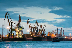 Shipyard with ships at dusk time Stock Photo