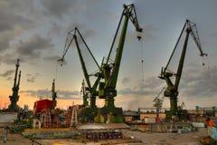 Shipyard at sunset Stock Images