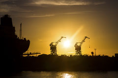 Shipyard at sunset Stock Photos