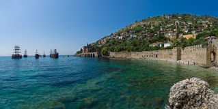 Shipyard (Tersane) and the ruins of a medieval fortress (Alanya Castle) on the mountainside. Royalty Free Stock Image