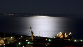 Shipyard under moonlight. View of Viktor Lenac shipyard and island Krk, Croatia under moonlight Royalty Free Stock Photos