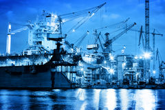 Shipyard at work, ship repair, freight. Industrial. Shipyard at work, ship repair. Industrial machinery, cranes. Transport, freight concept Stock Images