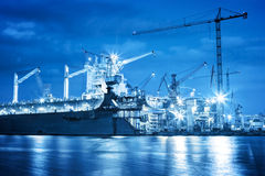 Shipyard at work, ship repair, freight. Industrial. Shipyard at work, ship repair. Industrial machinery, cranes. Transport, freight concept Stock Photography
