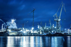 Shipyard at work, ship repair, freight. Industrial. Shipyard at work, ship repair. Industrial machinery, cranes. Transport, freight concept Royalty Free Stock Photography