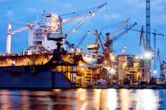 Shipyard at work, ship repair, freight. Industrial. Shipyard at work, ship repair. Industrial machinery, cranes. Transport, freight concept Stock Photo