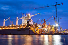 Shipyard at work, ship repair, freight. Industrial. Shipyard at work, ship repair. Industrial machinery, cranes. Transport, freight concept Royalty Free Stock Photo