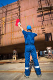 Shipyard workers Stock Images