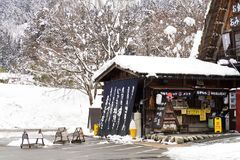 SHIRAKAWA GO, JAPAN - February 15, 2017: Beverage and softcream shop in Shirakawago ville. In winter with snow cover. stock images