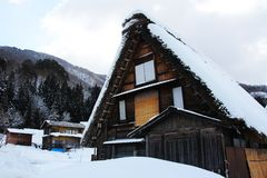 Shirakawa-go's historic house in snow. Historic house in Japanese village after heavy snowing Royalty Free Stock Photos
