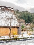 Shirakawa village in Gifu, Japan. E view of Gassho-zukuri unique architecture house in Shirakawa village, the UNESCO world heritage place, with snow in early Stock Photo