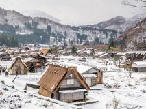Shirakawa village in Gifu, Japan. Gassho-zukuri unique architecture house in Shirakawa village, the UNESCO world heritage place, with snow in early winter season Royalty Free Stock Photo