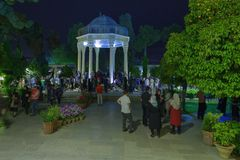 Visit Mausoleum of Hafez, the Persian Poet in Shiraz, Iran. Shiraz, Iran - 19 april, 2017: Mausoleum of the poet Hafez at night, Musalla Gardens in evening Royalty Free Stock Photography