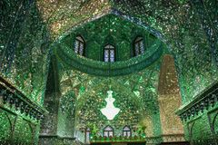 The magnificent beauty of the Shah-e-Cheragh Shrine mosque, decorated in green with numerous mirrors in Shiraz, Iran royalty free stock image