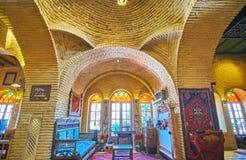 Enjoy Persian carpet store, Shiraz, Iran. SHIRAZ, IRAN - OCTOBER 14, 2017: The classic interior of carpet store with ornate vintage furniture, examples of stock photos