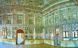 Panorama of mirror hall of Zinat Ol-Molk in Shiraz, Iran. SHIRAZ, IRAN - OCTOBER 12, 2017: Panorama of mirror hall of Zinat Ol-Molk mansion with complex patterns Stock Photos