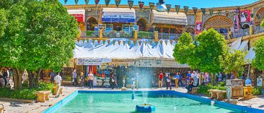 Panorama of Saraye Moshir Bazaar, Shiraz, Iran. SHIRAZ, IRAN - OCTOBER 14, 2017: Panorama of Saraye Moshir Bazaar Golshan Sara courtyard with numerous visitors royalty free stock photo