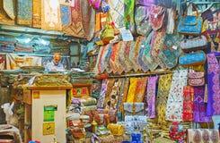 Traditional Persian textiles, Vakil Bazaar, Shiraz, Iran. SHIRAZ, IRAN - OCTOBER 14, 2017: The stall in Vakil Bazaar with wide range of silk tapestries, bags stock image