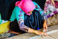 Shiraz, Iran on October 25th 2016, woman weaving carpet stock image