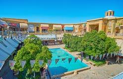 Saraye Moshir Bazaar, Shiraz, Iran. SHIRAZ, IRAN - OCTOBER 14, 2017: The upper terrace of Saraye Moshir Bazaar opens the view on small garden, fountain and stock images