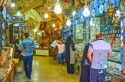 Explore Saraye Moshir Bazaar, Shiraz, Iran. SHIRAZ, IRAN - OCTOBER 14, 2017: Walk the curved alleyway of Saraye Moshir Bazaar Golshan Sara, lined with different stock image