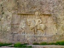 Shiraz, PERSEPOLIS, Naqsh-e Rustam, Iran Bassorilievo dell'impero persiano fotografia stock