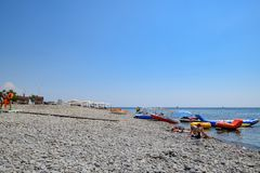 Shirokaya Balka Sea beach near the city of Novorossiysk. Infrastructure of the beach. Holidaymakers on the beach. Novorossiysk, Russia - August 06, 2018 stock photography