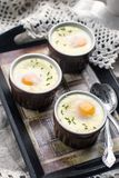 Shirred baked eggs for breakfast Royalty Free Stock Images