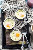 Shirred baked eggs for breakfast Stock Photography