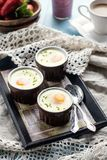 Shirred baked eggs for breakfast Royalty Free Stock Photography
