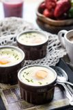 Shirred baked eggs for breakfast Stock Images