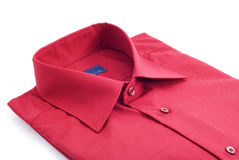 Shirt. Fastened red shirt on a white background Stock Photography