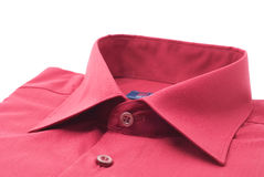 Shirt. Fastened red shirt on a white background Royalty Free Stock Photos