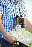 Shirt binoculars map Stock Photo