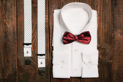 Shirt, casual suspenders and marsala bowtie. top view royalty free stock photo