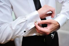 Shirt and cufflinks. Men wear a shirt and cufflinks Stock Image