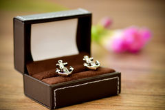 Shirt cufflinks shaped boat anchor stock image